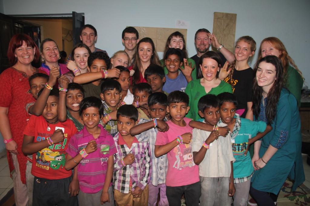Members of Wallace High School team with children of bal mandal from Mayapuri slum colony