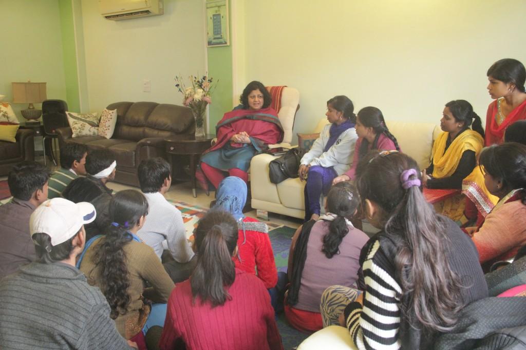 Dr Kiran speaking to children
