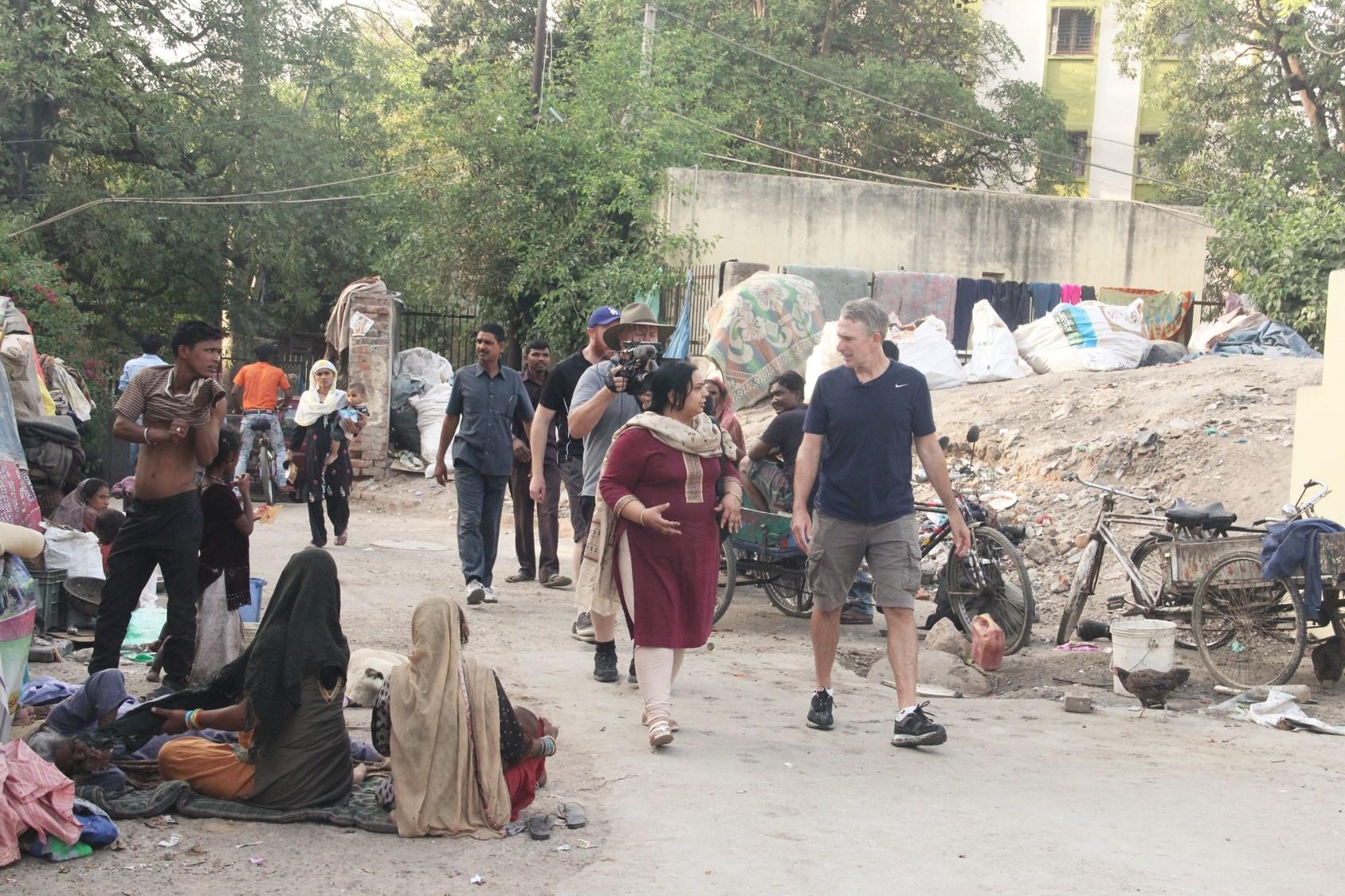 Damien entering Kanak Durga slum colony with Asha's Sr. Programme Coordinator, Ayesha