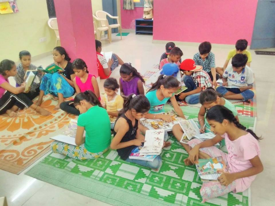 Bal Mandal children reading books at Ekta Vihar slum colony centre