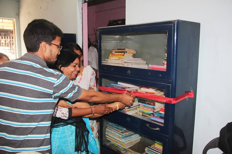 Library inauguration at Mayapuri slum colony by Asha staff Sweeta and Asha Student Ambassador Deepak