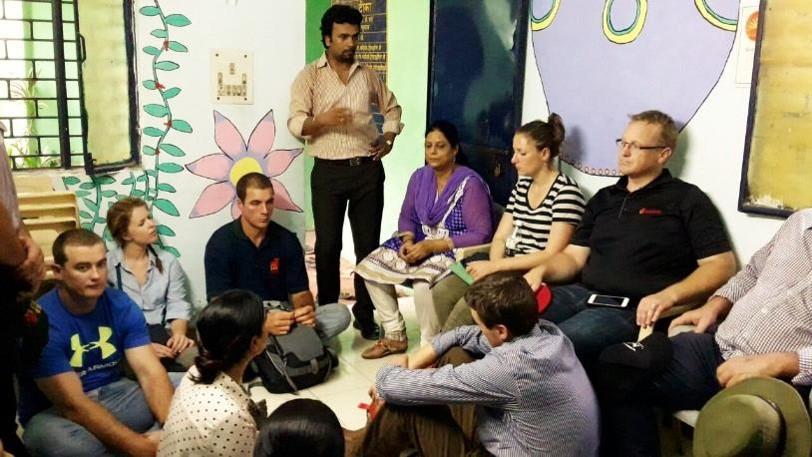 Asha Team Member, Jibin explaining the team about the work done in Kalkaji