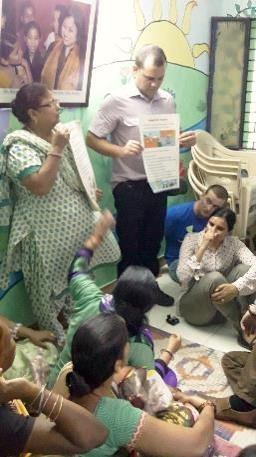 CHVs at Kalkaji explaining the use of health charts in the slums.