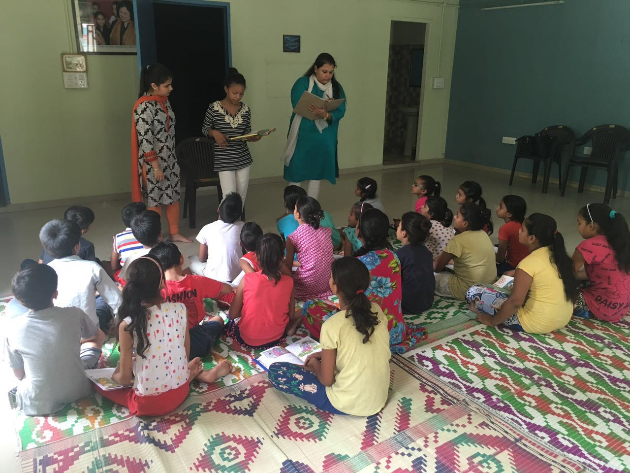 Interns teaching the students at Peeragarhi slum colony.