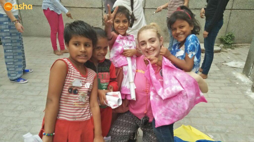 Royal School student posing with the Asha kids
