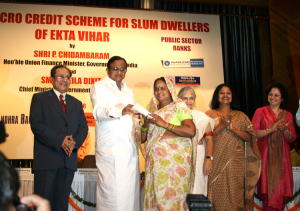 The then-Finance Minister, Mr P Chidambaram, presents cheques at an event to launch the loan scheme