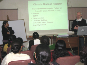 Dr Christopher Paxton from UK conducting workshop for Asha's healthcare staff