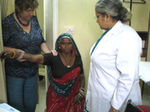 Dr Louise Dolan from UK examines a patient