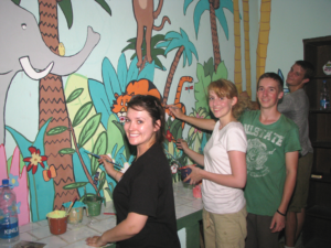 A team of students from the UK paint the Asha centre at Mayapuri slum colony