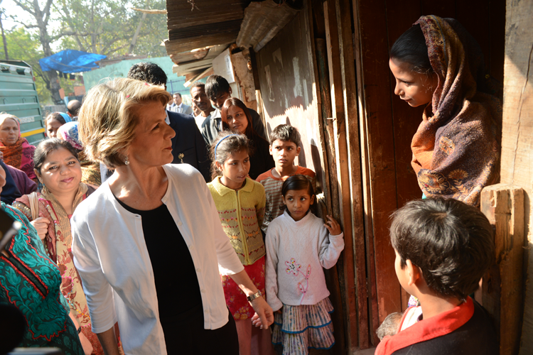 Ms. Bishop speaks to a young woman at Dr. Ambedkar slum colony
