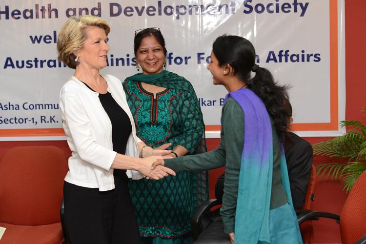 Ms. Bishop congratulates Babita for her achievements