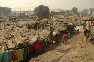 This is a typical slum in Delhi -shanty huts, made of cardboard, plastic sheets and pieces of cloth tightly packed together
