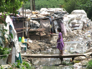 Slum dwellers live surrounded by dirty stagnant water, garbage and overflowing drains