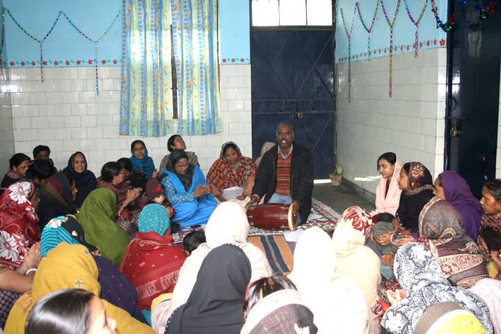 Women's group members at Seelampur colony singing at the Christmas Party