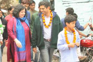 Dr Kiran and Asha students welcome Harish Rao