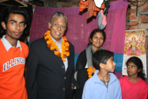 Mr. Karthikeyan with daughter Kanchana and her children at an Asha student's home