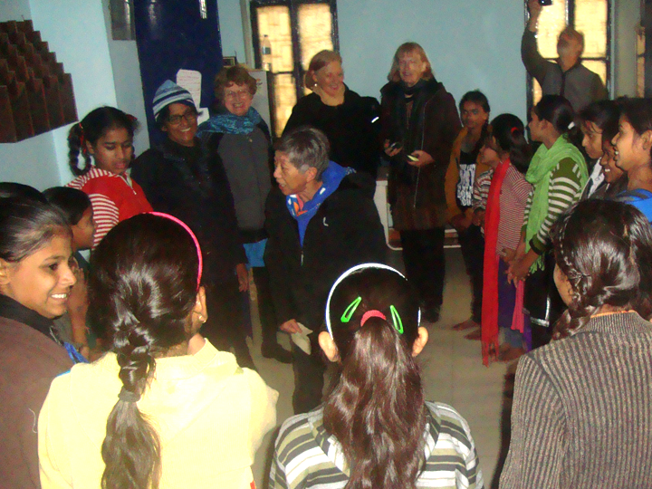 The team teaches action songs to children