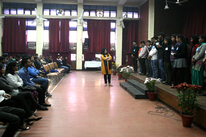 The Student Ambassadors introduce themselves to the Asha family as Dr Kiran looks on