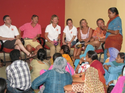 A member of Women's Group tells her story to the visitors