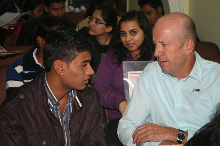 Rinku, student from Chanderpuri slum colony in conversation with his mentor Mr Mark Westerna