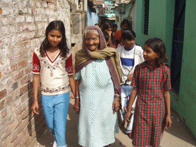 Member's of Children's Group Accompany an old lady to Asha's Healthcare