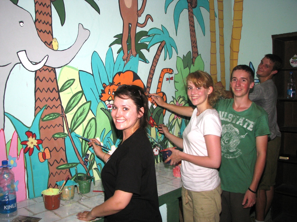 Above: Members of the team painting the children's resource center at Mayapuri in a vibrant jungle theme