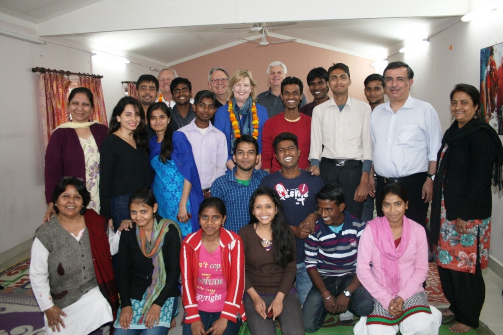 The visitors pose for a group photograph with college and high school students and members of the Asha Team