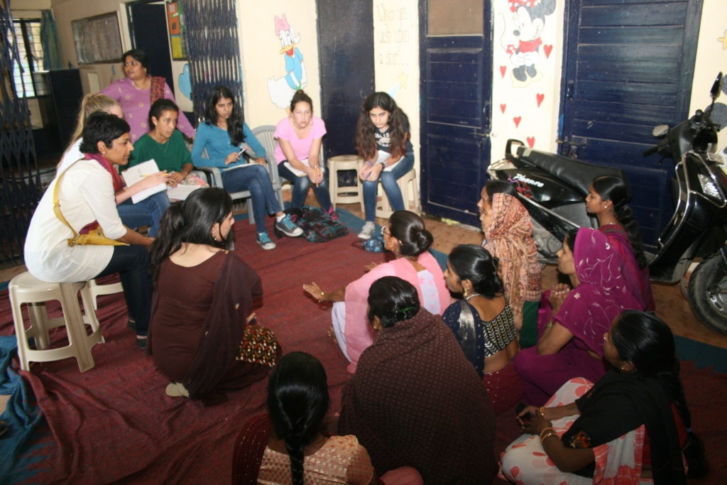 Students interacting with members of the women's association