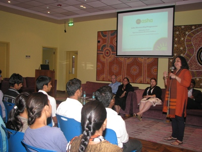 Dr Kiran Martin welcoming the panelists at the event