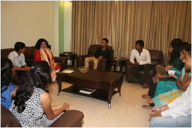 Dr Kiran in conversation with the students at her residence