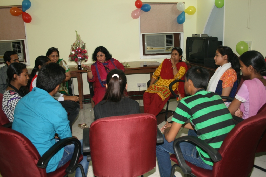 Dr Kiran counselling the students
