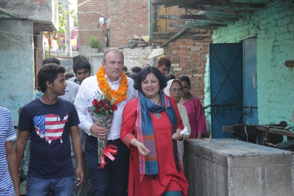 Mr Edward Davey, Secretary of State for Energy and Climate Change, UK entering Kanak Durga slum colony with Dr Kiran Martin