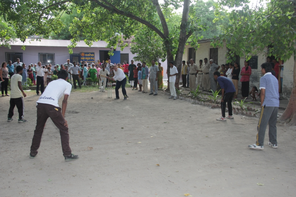 Mr Edward Davey playing cricket with Asha college students
