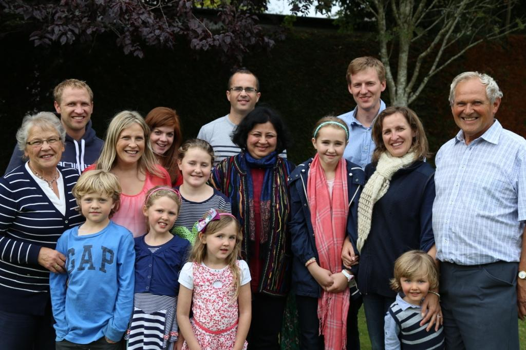 Dr Kiran with Mr Angus Cuthbert and his family