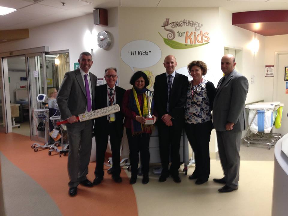 Dr Kiran with the senior staff members of Bendigo Health as they flaunt their trophy from the Match