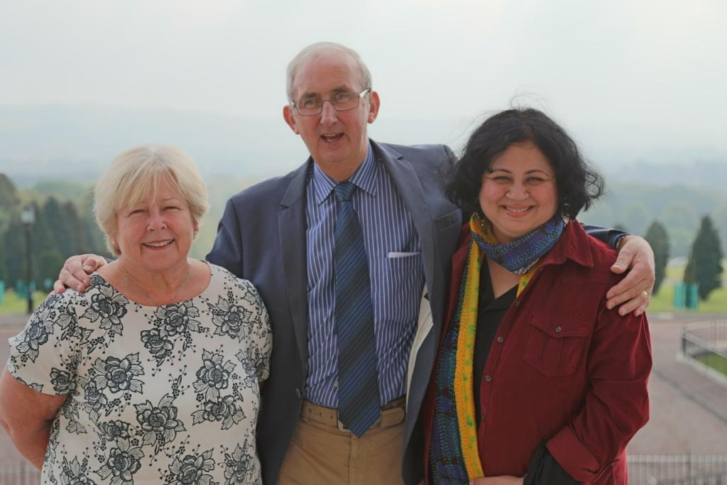 Gordon Wright, Dr Kiran and volunteer Michelle outside the Stormont Buildings