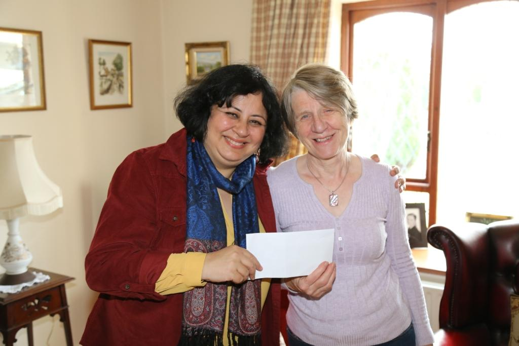 Mita Preston presented Dr Kiran with a gift from the Women's Outreach Group at Whitehead.