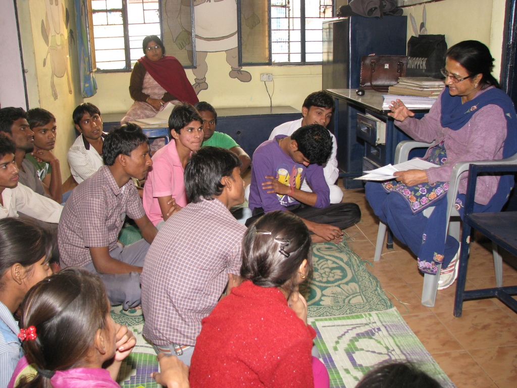 Asha staff motivates children to study better for their exams