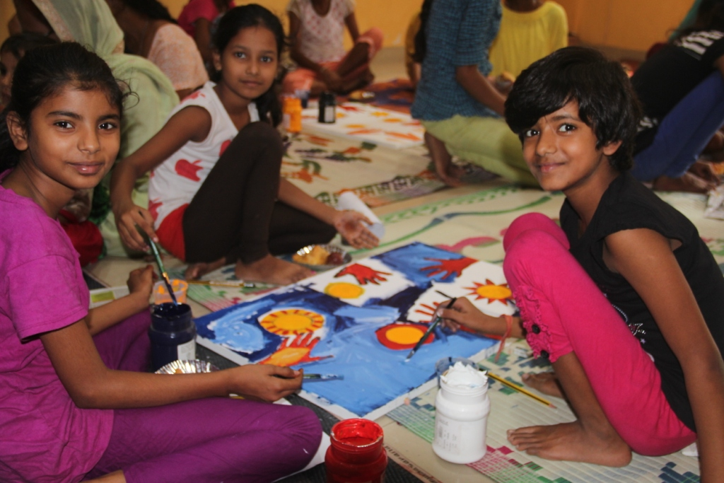 Children enjoying the painting session