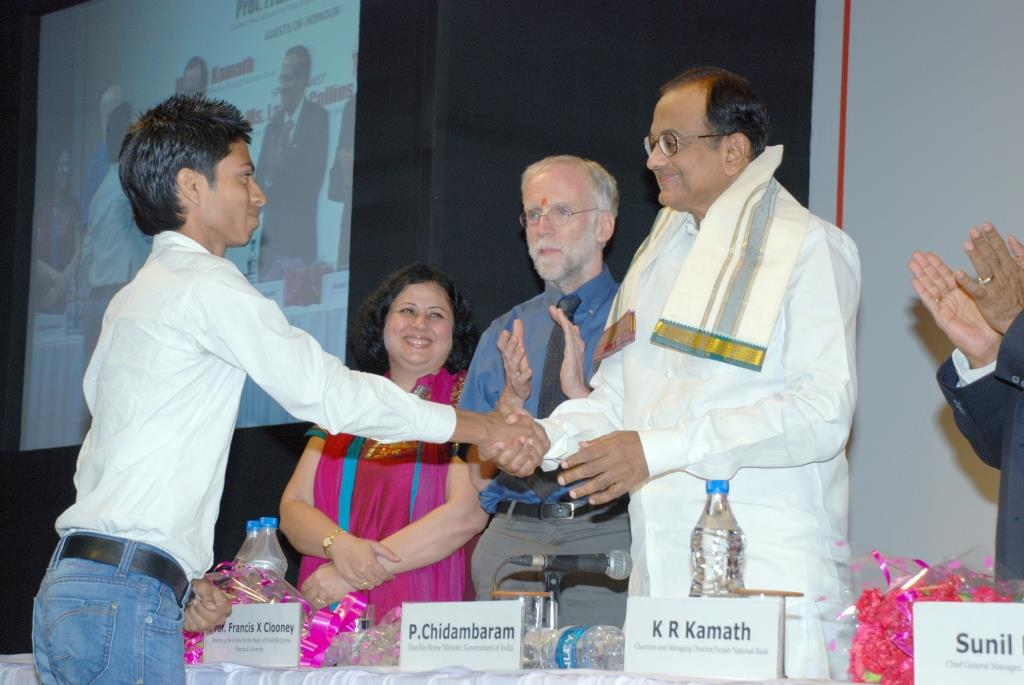 New graduate Diwakar, thanks the Home Minister for his years of support of the Higher Education Programme