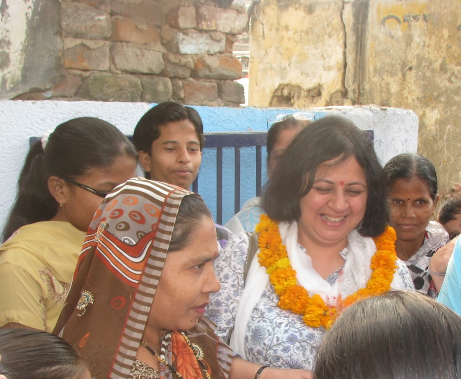 Dr Martin interacting with residents of Zakhira slum colony