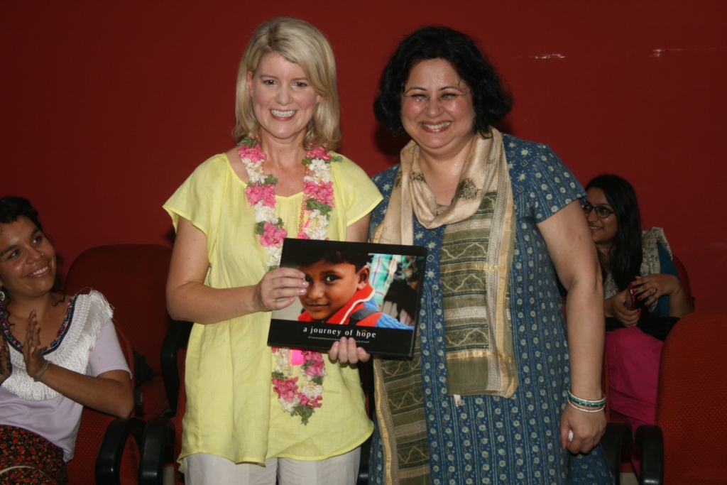 Dr Kiran presenting Ms Despoja with a copy of A Journey of Hope a coffee table book on the work of Asha as memento of her visit