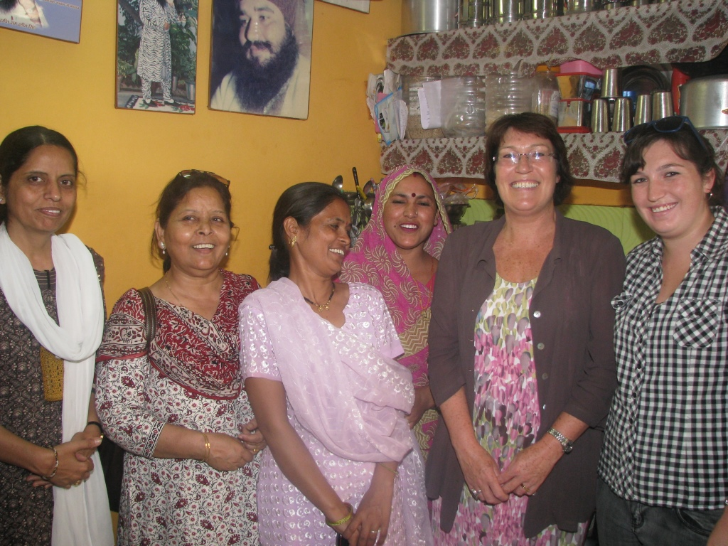 HE Ms Henderson and her daugher with Asha staff visiting a home in the slum