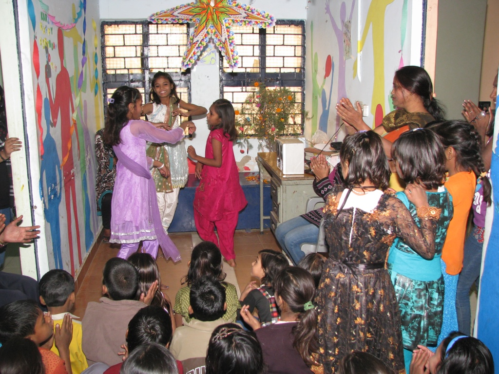 Children giving a dance performance at one of our slum centres