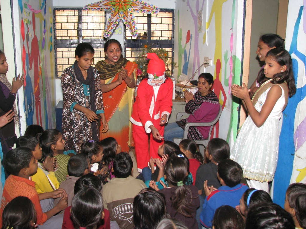 Santa distributing gifts to the children