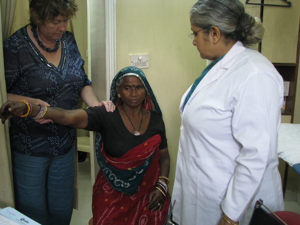 Dr Louise Dolan examining a patient at the Asha Polyclinic
