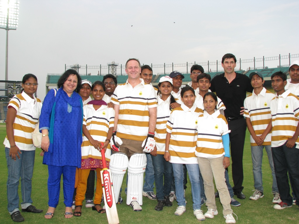 Prime Minister Key, Dr Martin, Mr Stephen Fleming, and the students before the cricket match