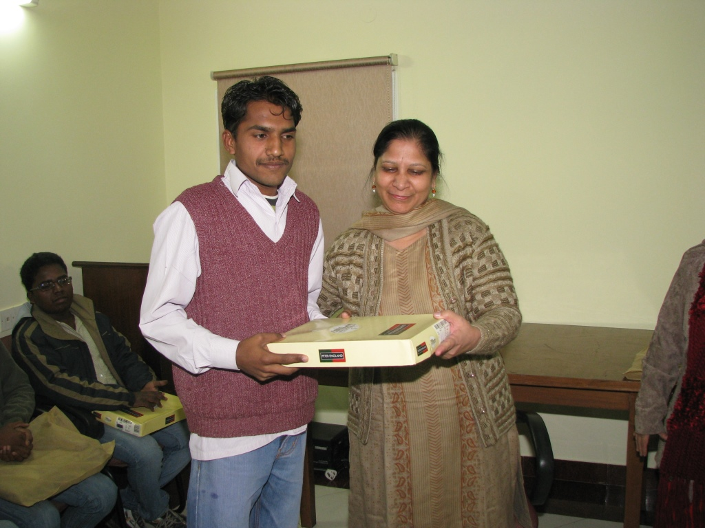 Anu receiving his Christmas gift from Asha staff