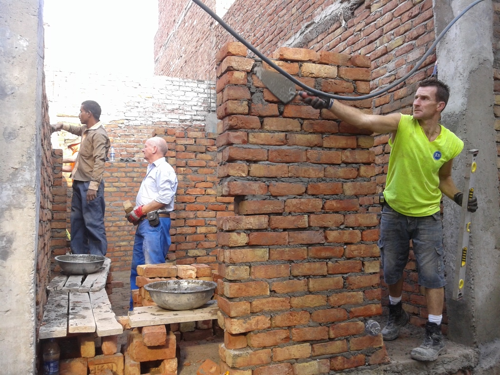 The Ballymena builders constructing the house of Rajendra Yadav in Saavda slum colony
