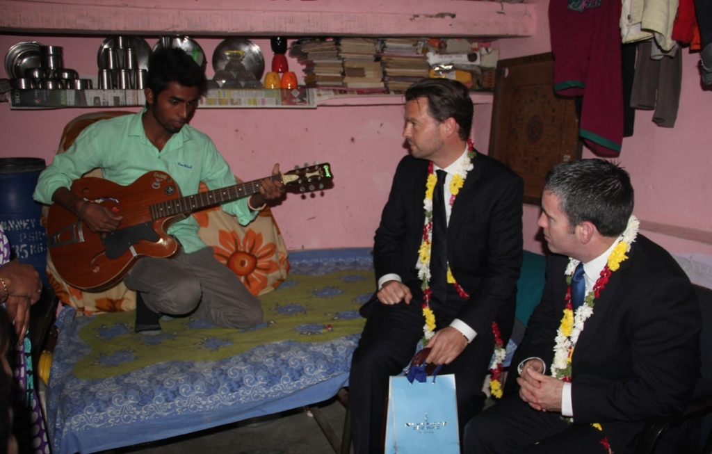 Gaurav singing for Minister English and Ambassador McLaughlin when they visited his home